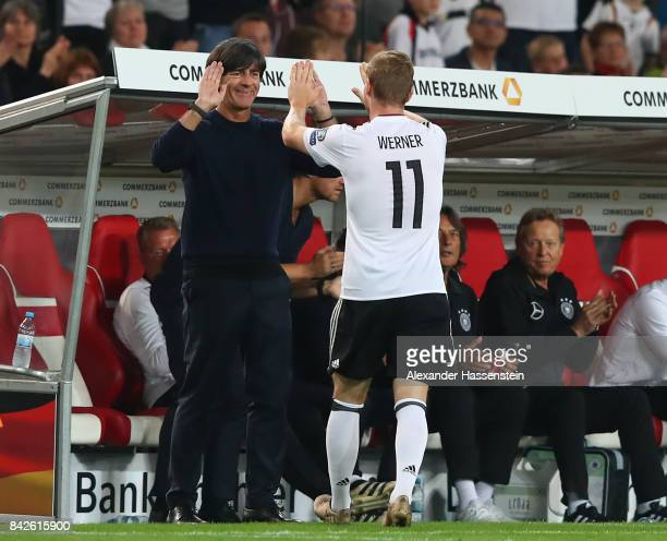 Timo Werner of Germany with Joachim Loew national coach of Germany as he is being substituted during the FIFA 2018 World Cup Qualifier between...