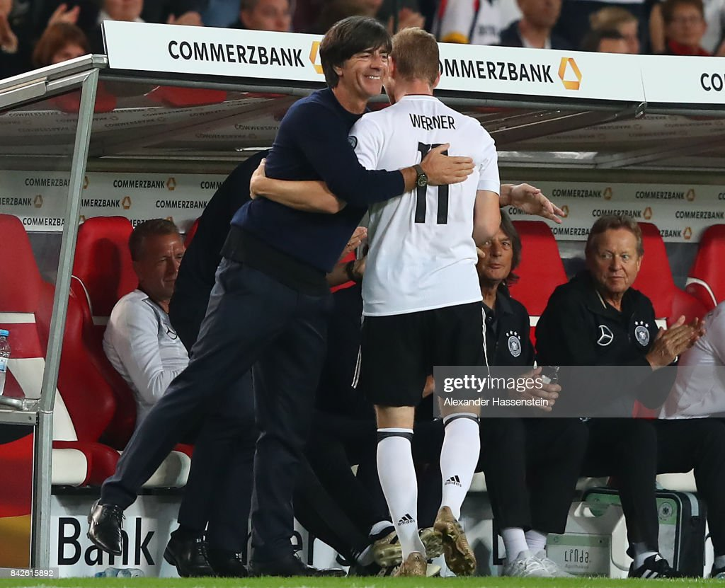Timo Werner of Germany (r) with Joachim Loew, national coach of Germany, embrace as he is being substituted during the FIFA 2018 World Cup Qualifier between Germany and Norway at Mercedes-Benz Arena on September 4, 2017 in Stuttgart, Baden-Wuerttemberg.