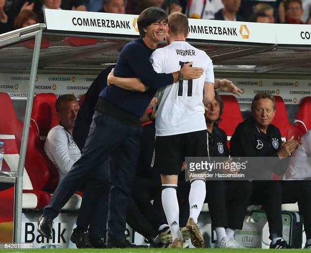 Timo Werner of Germany with Joachim Loew national coach of Germany embrace as he is being substituted during the FIFA 2018 World Cup Qualifier...