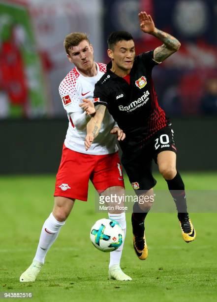 Timo Werner of Leipzig and Charles Aranguiz of Leverkusen battle for the ball during the Bundesliga match between RB Leipzig and Bayer 04 Leverkusen...