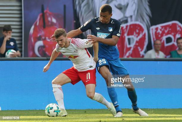 Timo Werner of Leipzig battles for the ball with Kevin Akpoguma of Hoffenheim during the Bundesliga match between RB Leipzig and TSG 1899 Hoffenheim...