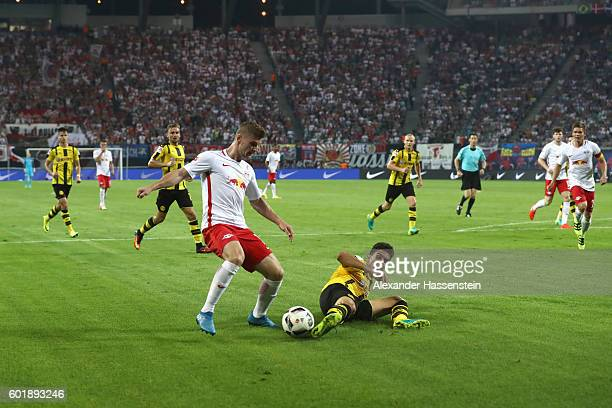 Timo Werner of Leipzig battles for the ball with Marc Barta of Dortmund during the Bundesliga match between RB Leipzig and Borussia Dortmund at Red...