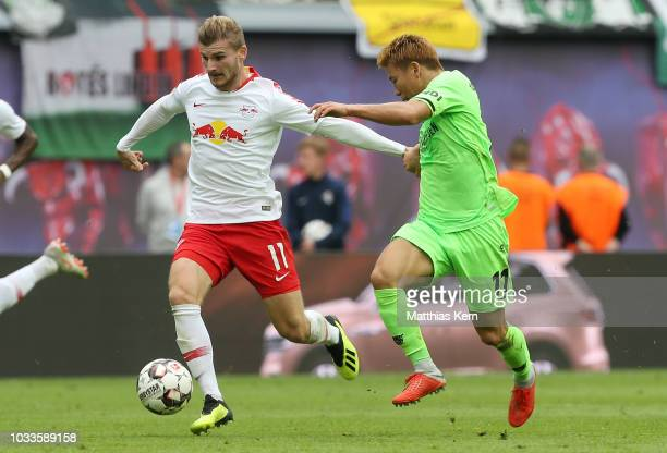 Timo Werner of Leipzig battles for the ball with Takuma Asano of Hannover during the Bundesliga match between RB Leipzig and Hannover 96 at Red Bull...