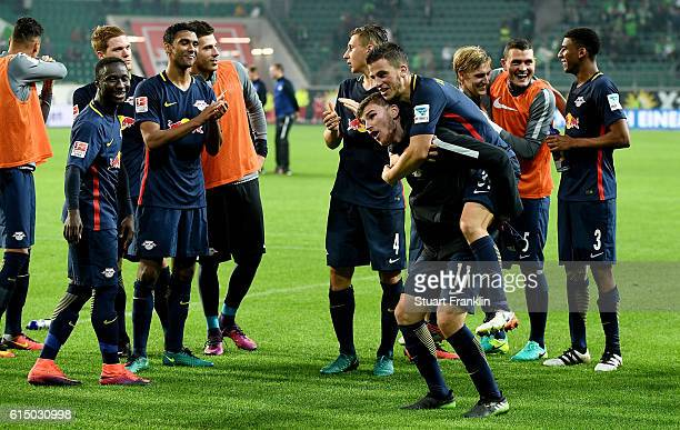 Timo Werner of Leipzig celebrate with his team mates after the Bundesliga match between VfL Wolfsburg and RB Leipzig at Volkswagen Arena on October...