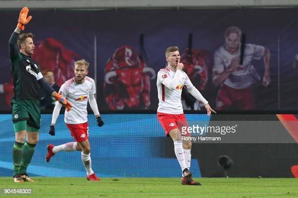 Timo Werner of Leipzig celebrates after he scored a goal to make it 21 as Ralf Faehrmann of Schalke raises his arm in protest during the Bundesliga...