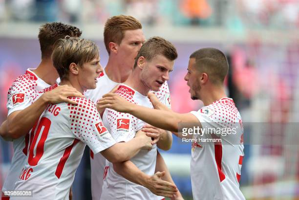 Timo Werner of Leipzig celebrates after scoring his team's first goal with Willi Orban Emil Forsberg Marcel Halstenberg and Diego Demme of Leipzig...