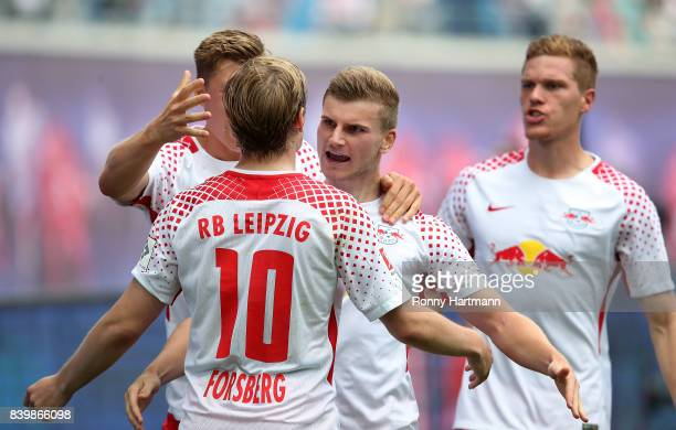 Timo Werner of Leipzig celebrates after scoring his team's first goal with Emil Forsberg Willi Orban and Marcel Halstenberg of Leipzig during the...