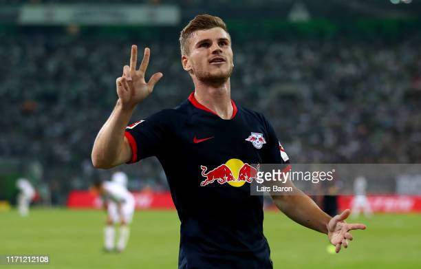 Timo Werner of Leipzig celebrates after scoring his teams third goal during the Bundesliga match between Borussia Moenchengladbach and RB Leipzig at...
