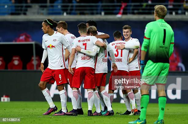 Timo Werner of Leipzig celebrates after scoring his team's third goal with team mates during the Bundesliga match between RB Leipzig and 1 FSV Mainz...