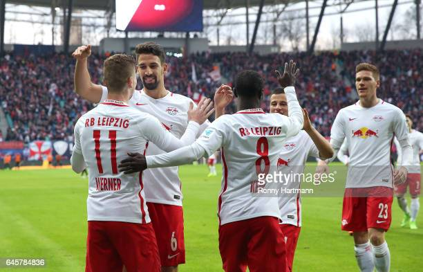 Timo Werner of Leipzig celebrates after scoring his team's third goal with Rani Khedira Naby Deco Keita Diego Demme and Marcel Halstenberg of Leipzig...