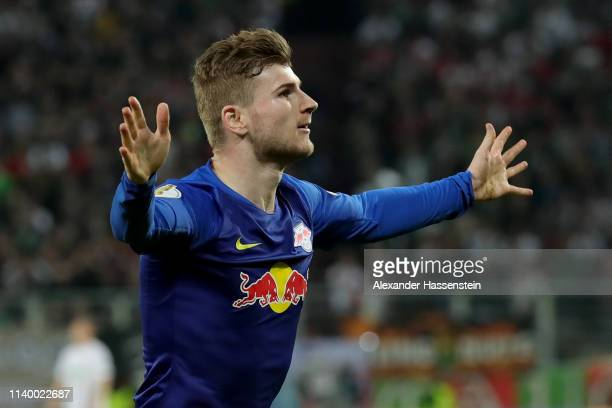 Timo Werner of Leipzig celebrates scoring the opening goal during the DFB Cup match between FC Augsburg and RB Leipzig at WWKArena on April 02 2019...