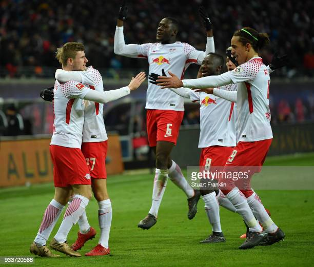 Timo Werner of Leipzig celebrates scoring the winning goal during the Bundesliga match between RB Leipzig and FC Bayern Muenchen at Red Bull Arena on...