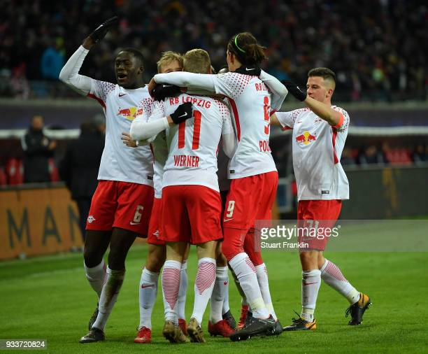 Timo Werner of Leipzig celebrates scoring the winning goal with teamates during the Bundesliga match between RB Leipzig and FC Bayern Muenchen at Red...