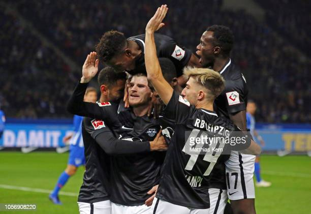Timo Werner of Leipzig celebrates with teammates after scoring his team's first goal during the Bundesliga match between Hertha BSC and RB Leipzig at...