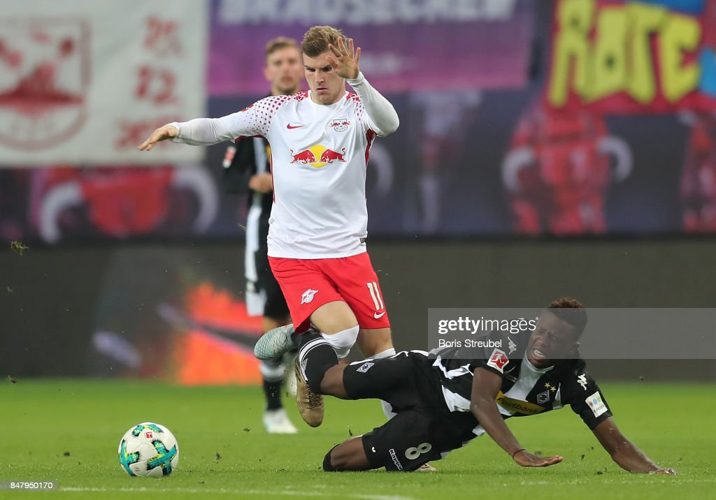 Timo Werner of Leipzig (top) fights for the ball with Denis Zakaria of Moenchengladbach during the Bundesliga match between RB Leipzig and Borussia Moenchengladbach at Red Bull Arena on September 16, 2017 in Leipzig, Germany.