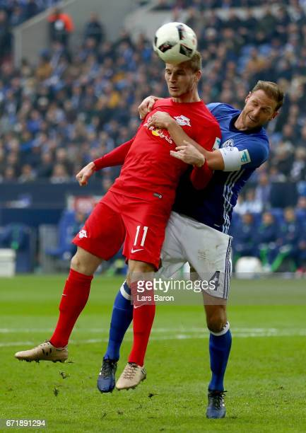 Timo Werner of Leipzig heads his teams first goal against Benedikt Hoewedes of Schalke during the Bundesliga match between FC Schalke 04 and RB...
