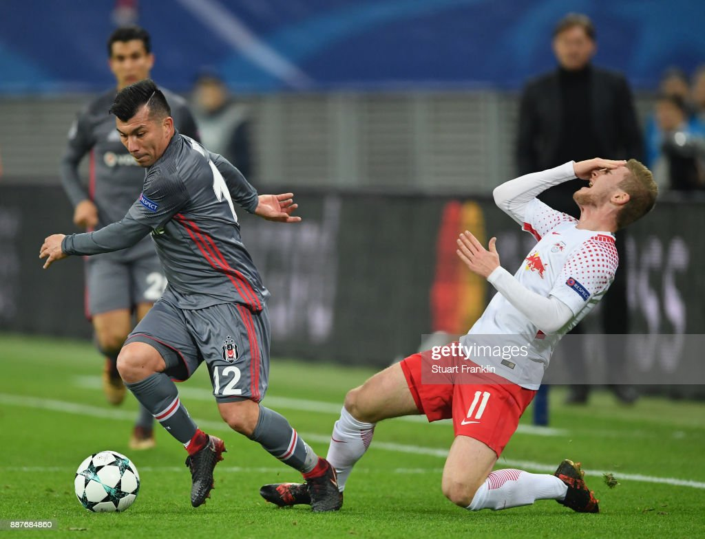 Timo Werner of Leipzig is challenged by Gary Medel of Besiktas during the UEFA Champions League group G match between RB Leipzig and Besiktas at Red Bull Arena on December 6, 2017 in Leipzig, Germany.
