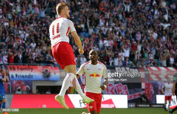 Timo Werner of Leipzig jubilates with team mate Ademola Lookman after scoring the second goal during the Bundesliga match between RB Leipzig and VfL...
