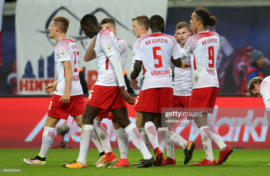 Timo Werner (R) of Leipzig jubilates with team mates after scoring the third goal during the Bundesliga match between RB Leipzig and Hannover 96 at Red Bull Arena on November 4, 2017 in Leipzig, Germany.