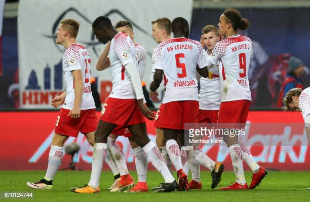 Timo Werner of Leipzig jubilates with team mates after scoring the third goal during the Bundesliga match between RB Leipzig and Hannover 96 at Red...