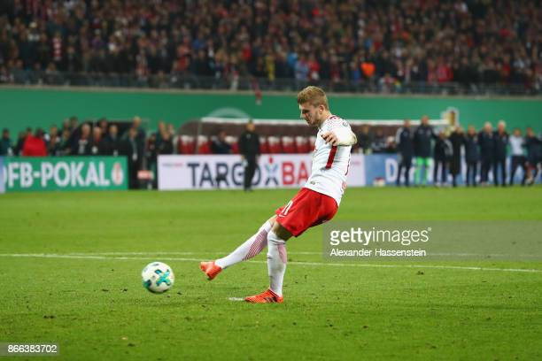 Timo Werner of Leipzig kicks a penalty during the DFB Cup round 2 match between RB Leipzig and Bayern Muenchen at Red Bull Arena on October 25 2017...