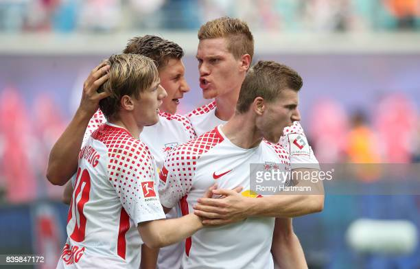 Timo Werner of Leipzig of Leipzig celebrates after scoring his team's first goal with Emil Forsberg Willi Orban and Marcel Halstenberg of Leipzig...