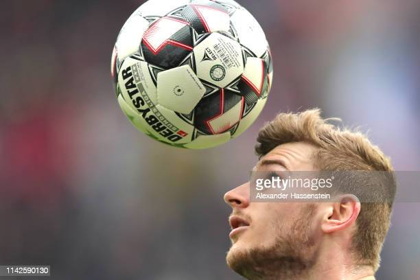 Timo Werner of Leipzig plays with the ball during the Bundesliga match between RB Leipzig and VfL Wolfsburg at Red Bull Arena on April 13 2019 in...