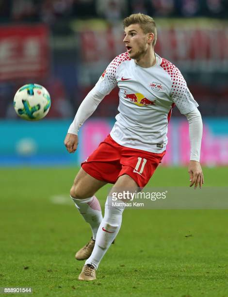 Timo Werner of Leipzig runs with the ball during the Bundesliga match between RB Leipzig and 1FSV Mainz 05 at Red Bull Arena on December 9 2017 in...
