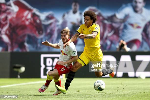 Timo Werner of RB Leipzig and Axel Witsel of Borussia Dortmund battle for possession during the Bundesliga match between RB Leipzig and Borussia...