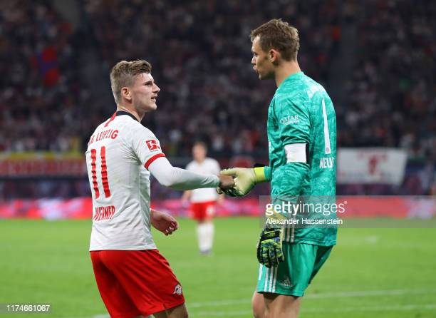 Timo Werner of RB Leipzig and Manuel Neuer of FC Bayern Munich in discussion during the Bundesliga match between RB Leipzig and FC Bayern Muenchen at...