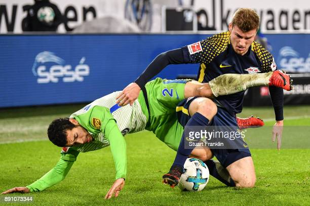 Timo Werner of RB Leipzig and William of VfL Wolfsburg battle for the ball during the Bundesliga match between VfL Wolfsburg and RB Leipzig at...