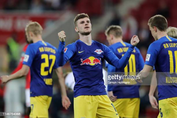 Timo Werner of RB Leipzig celebrates after he scores his sides third goal during the Bundesliga match between 1. FSV Mainz 05 and RB Leipzig at Opel...
