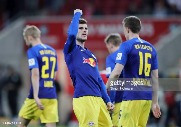 Timo Werner of RB Leipzig celebrates after he scores his sides third goal during the Bundesliga match between 1 FSV Mainz 05 and RB Leipzig at Opel...
