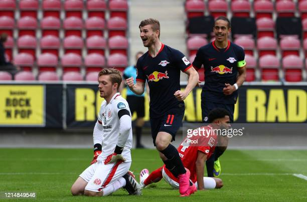 Timo Werner of RB Leipzig celebrates after scoring his sides fourth goal during the Bundesliga match between 1. FSV Mainz 05 and RB Leipzig at Opel...