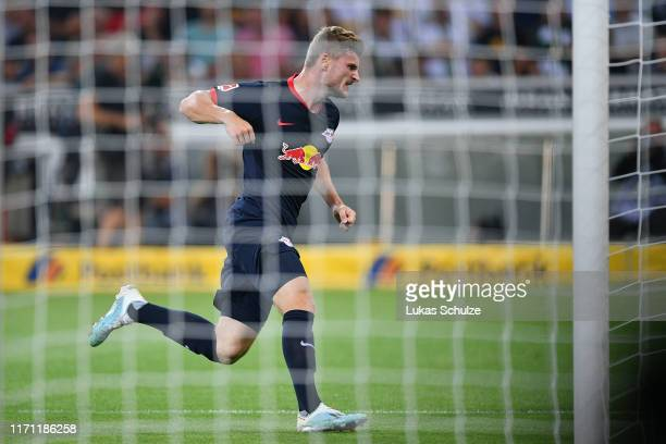Timo Werner of RB Leipzig celebrates after scoring his team's first goal during the Bundesliga match between Borussia Moenchengladbach and RB Leipzig...