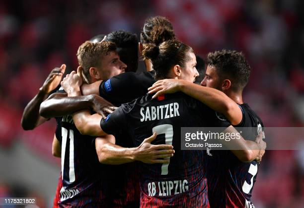 Timo Werner of RB Leipzig celebrates after scoring his team's first goal with team mates during the UEFA Champions League group G match between SL...