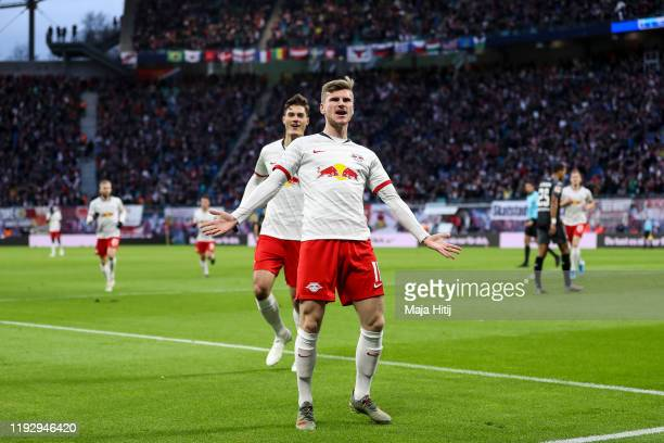 Timo Werner of RB Leipzig celebrates after scoring his team's first goal during the Bundesliga match between RB Leipzig and TSG 1899 Hoffenheim at...
