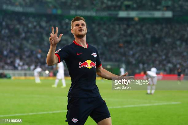 Timo Werner of RB Leipzig celebrates after scoring his team's third goal during the Bundesliga match between Borussia Moenchengladbach and RB Leipzig...
