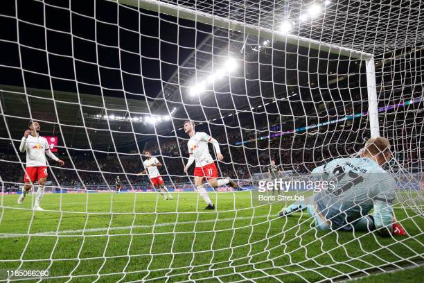 Timo Werner of RB Leipzig celebrates scoring his team's eighth goal past Robin Zentner of 1 FSV Mainz 05 during the Bundesliga match between RB...