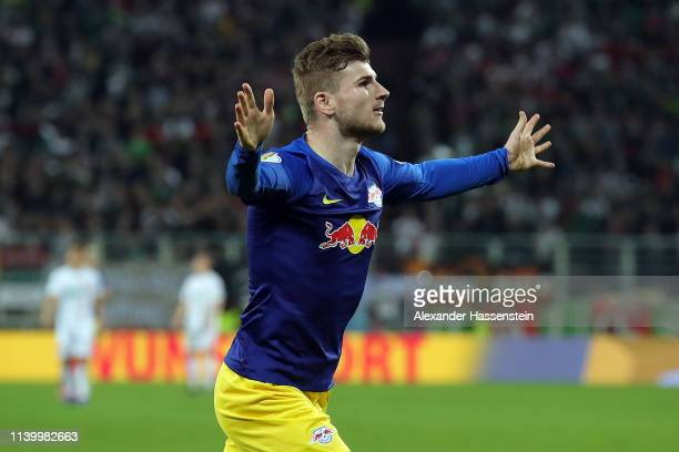 Timo Werner of RB Leipzig celebrates scoring the first goal during the DFB Cup match between FC Augsburg and RB Leipzig at WWKArena on April 02 2019...