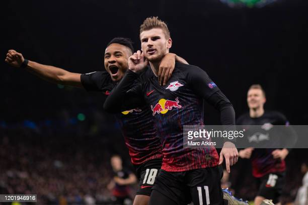 Timo Werner of RB Leipzig celebrates scoring the opening goal with Christopher Nkunku during the UEFA Champions League round of 16 first leg match...