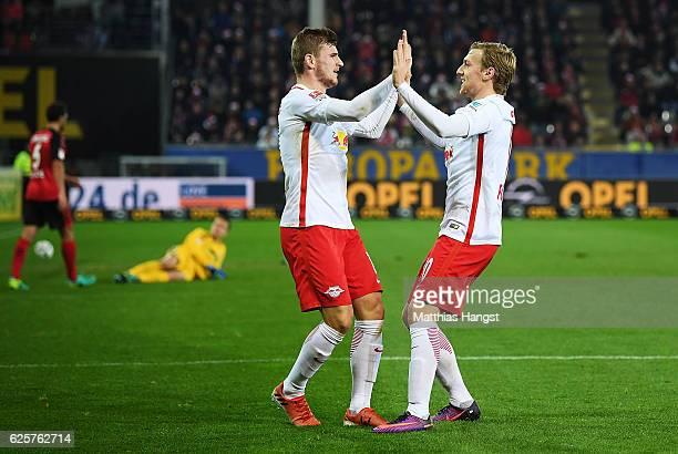 Timo Werner of RB Leipzig celebrates with Emil Forsberg of RB Leipzig after scoring his second goal during the Bundesliga match between SC Freiburg...