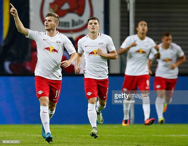 Timo Werner of RB Leipzig celebrates with his team mates after scoring her team's first goal during the Bundesliga match between RB Leipzig and...