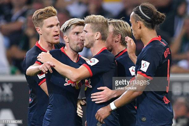 Timo Werner of RB Leipzig celebrates with his team mates after scoring his team's first goal during the Bundesliga match between Borussia...