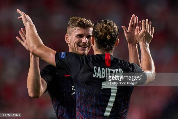 Timo Werner of RB Leipzig celebrates with Marcel Sabitzer of RB Leipzig after scoring his team's second goal during the UEFA Champions League group G...