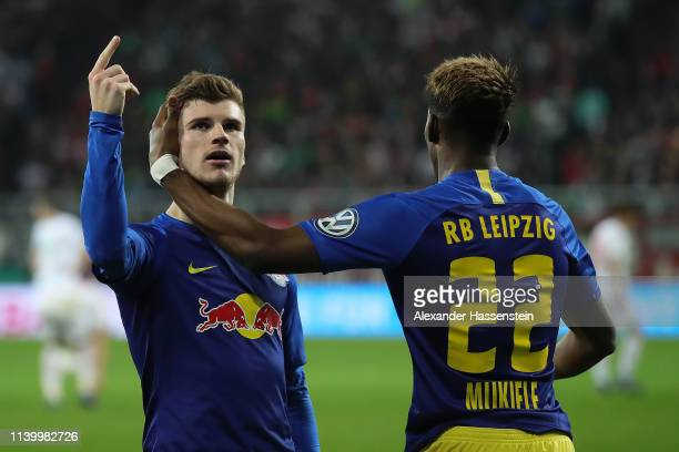 Timo Werner of RB Leipzig celebrates with team mate Nordi Mukiele after scoring the first goal during the DFB Cup match between FC Augsburg and RB...