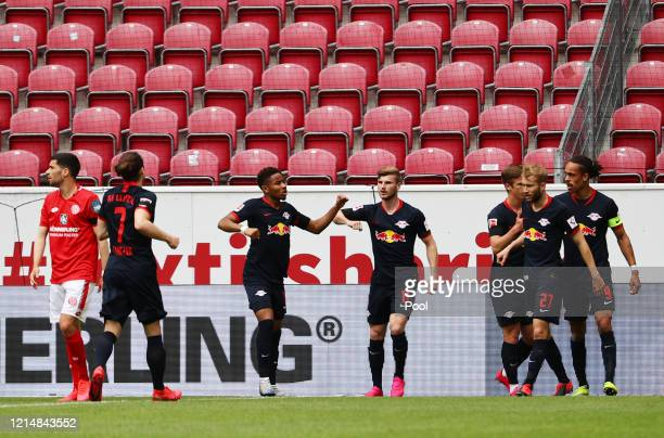 Timo Werner of RB Leipzig celebrates with team mates after scoring his sides first goal during the Bundesliga match between 1. FSV Mainz 05 and RB...
