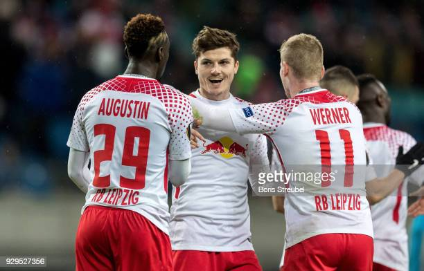 Timo Werner of RB Leipzig celebrates with team mates after scoring his team's second goal during UEFA Europa League Round of 16 match between RB...