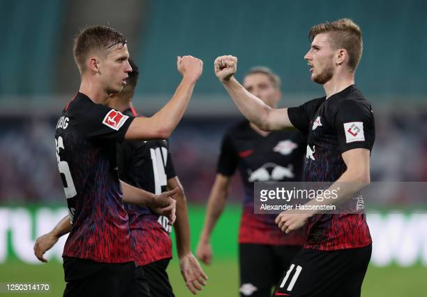 Timo Werner of RB Leipzig celebrates with teammate Dani Olmo of RB Leipzig after scoring his team's second goal during the Bundesliga match between...