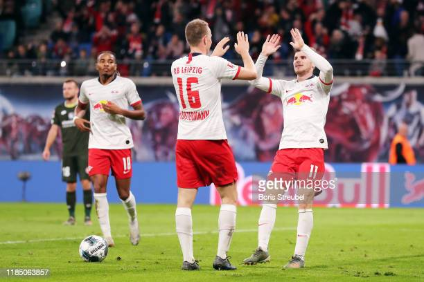 Timo Werner of RB Leipzig celebrates with teammate Lukas Klostermann after scoring his team's eighth goal during the Bundesliga match between RB...